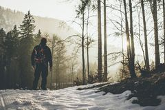 Man hiker come back home at sunset outdoor activity in winter time stock photos