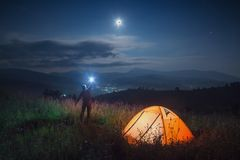 Man hiker with flashlight Stock Images