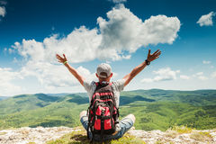 Free Man Hiker Greeting Rich Nature On The Top Of Mountain Stock Photo - 41057500