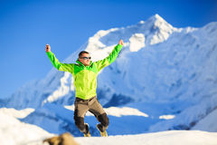 Man hiker happy jump in winter mountains Stock Photos