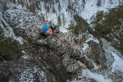 Man hiker have rest at mountain top, relax lying on rock. Man hiker have rest at mountain top, relax lying on rock Royalty Free Stock Photos