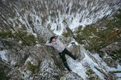Man hiker have rest at mountain top, relax lying on rock. Man hiker have rest at mountain top, relax lying on rock Royalty Free Stock Photo