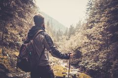 Man hiker in mountain forest Stock Photography