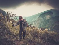 Man hiker in mountain forest Royalty Free Stock Photo