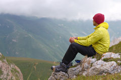 Man Hiker in Mountains relaxing Royalty Free Stock Image