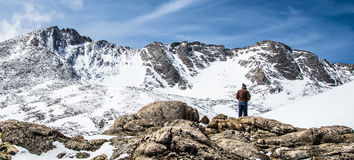 Man Hiker Overlooking Mount Evans Summit - Colorado stock image