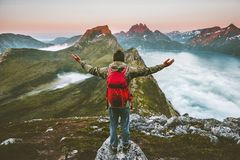Man hiker raised hands exploring mountains of Norway stock image