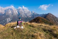 Man hiker sit and watch the landscape of mountain in autumn fro. M the mountain top stock photography