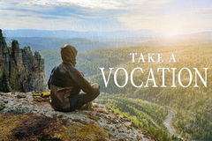 Man hiker sitting on top of mountain and contemplates beautiful view to the valley. Take a Vocation lettering. Man hiker sitting on top of mountain and Royalty Free Stock Images