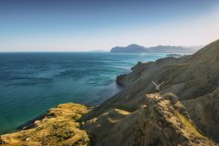 Man hiker standing on a cliffs edge stock photo