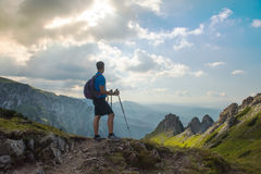 Man hiker on top of mountain Royalty Free Stock Image