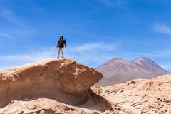 Man hiker on a top of a rock. Nacional park Uyuni, Altiplano, Bolivia royalty free stock photos