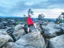 Man hiker with trekking clothes on a top. Fall nature. royalty free stock image
