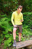 Man hiker using smartphone in forest Stock Images