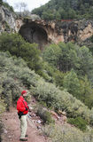 A Man Hikes into Pine Canyon Towards Tonto Natural Bridge Stock Photography