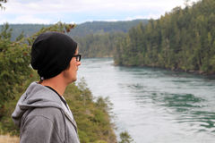 Man Hiking. Man in hat and sweat shirt hikes to a beautiful river Stock Images