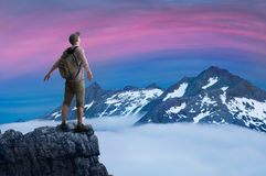 Man hiking. A man hiking in mountains stock photo