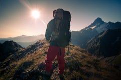 Man hiking. In a mountain Stock Photo