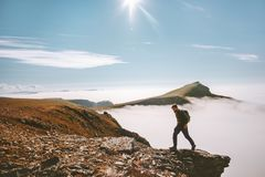Man hiking alone in mountains active summer vacations stock photos