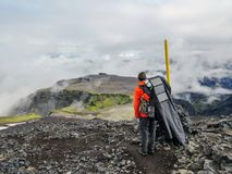 Man hiking alone into the wild admiring volcanic landscape with heavy backpack. Travel lifestyle adventure wanderlust concept stock images