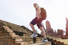 Man hiking ancient ruins Stock Photo