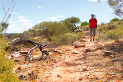 Man hiking Australian outback Stock Photos