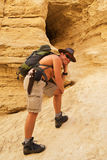 Man hiking with backpack. Negev desert. Israel Stock Photo