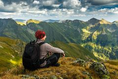 Hiker with backpack on mountains Stock Image