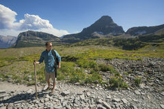 Man hiking in in the beautiful mountains of Glacier National Park Stock Images