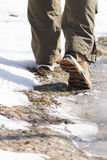 Man in hiking boots walking in forest Royalty Free Stock Photos