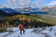 Man hiking in Canadian Rockies. Stock Photos