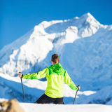 Man hiking climbing winter mountains in Nepal Stock Photo