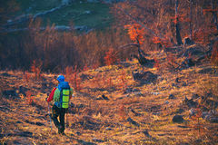 Man hiking descend to the mountain. Young man hiking descend to the mountain Royalty Free Stock Images