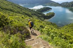 Man Hiking down to Lagoa do Fogo In Sao Miguel Azores