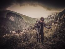 Man with hiking equipment walking in mountain Royalty Free Stock Photography