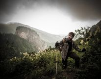 Man with hiking equipment walking in mountain Royalty Free Stock Photos