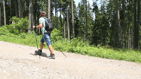 Man hiking hill up stock footage