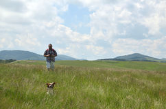 Man Hiking with His Dog stock photos
