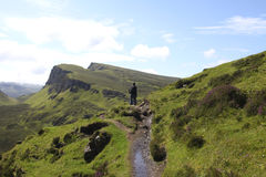 Man hiking on the isle of Skye in Scotland Royalty Free Stock Images