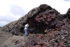 Man hiking in lava splatter zone royalty free stock photo