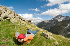 Man hiking in mountain Stock Images