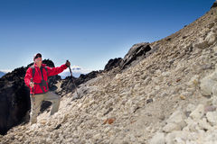 Man hiking in a mountain Royalty Free Stock Image