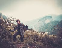 Man hiking in a mountain forest Stock Photos