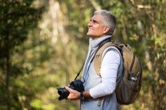 Man hiking mountain Stock Images