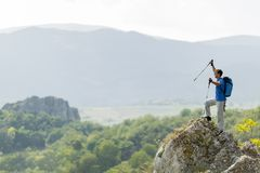Man hiking on the mountain Stock Images