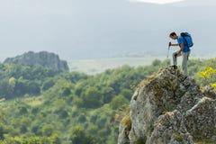 Man hiking on the mountain Royalty Free Stock Image