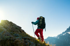 Man hiking in mountains stock images