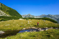 Man hiking in the mountains on a tourist track Stock Photo