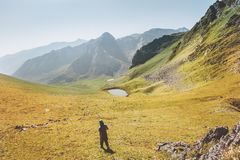 Man hiking in mountains valley travel adventure active lifestyle royalty free stock images