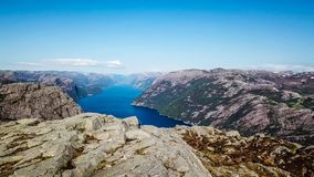 A man hiking near a fjord in norway. Drone picture royalty free stock photo